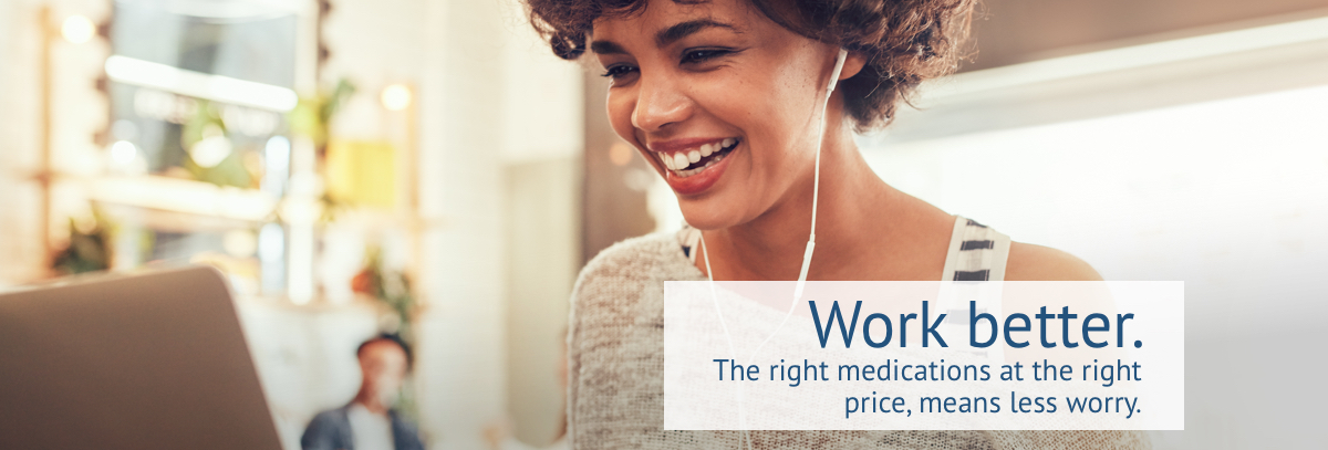 Smiling young woman with white earphones viewing Sun Life Preferred Pharmacy Network website on laptop