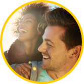 Woman and man smiling after using Sun Life Preferred Pharmacy Network